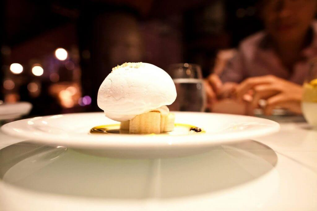 Nitro Coconut Floating Island-The coconut puff basking on fresh banana slices was fluffy & light.